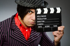 The funny man with movie board Royalty Free Stock Photography