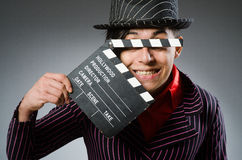 The funny man with movie board Royalty Free Stock Image