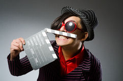 The funny man with movie board Royalty Free Stock Photo