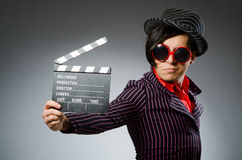 The funny man with movie board Stock Photography