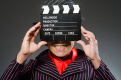 The funny man with movie board Royalty Free Stock Images