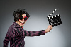 The funny man with movie board Stock Image
