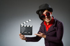 The funny man with movie board Royalty Free Stock Photos