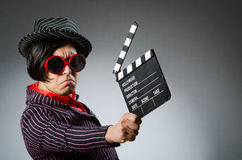 The funny man with movie board Stock Images