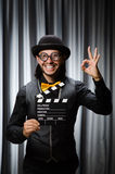 Funny man with movie board Stock Images