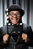 Funny man with movie board Royalty Free Stock Images