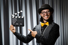 Funny man with movie board Stock Photo