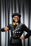 Funny man with movie board Stock Photography