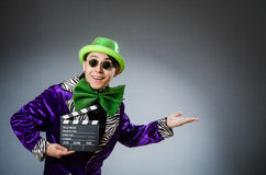 The funny man with movie clapboard. Funny man with movie clapboard Royalty Free Stock Image