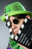 The funny man with movie clapboard. Funny man with movie clapboard Royalty Free Stock Photography