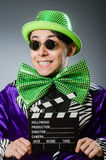 The funny man with movie clapboard Royalty Free Stock Photos