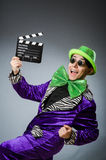 The funny man with movie clapboard. Funny man with movie clapboard Royalty Free Stock Images