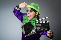 The funny man with movie clapboard. Funny man with movie clapboard Stock Photos