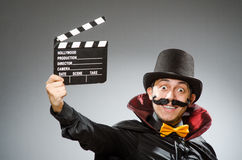 The funny man with movie clapboard. Funny man with movie clapboard Stock Image