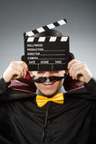 The funny man with movie clapboard. Funny man with movie clapboard Royalty Free Stock Photo