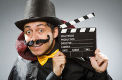 The funny man with movie clapboard Stock Images