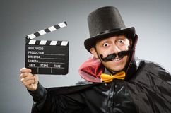 Funny man with movie clapboard Royalty Free Stock Photo