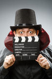 Funny man with movie clapboard. The funny man with movie clapboard Stock Photos