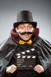 The funny man with movie clapboard. Funny man with movie clapboard Stock Photography