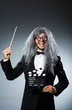 The funny man with movie clapboard Stock Photo