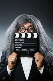 The funny man with movie clapboard. Funny man with movie clapboard Stock Photo