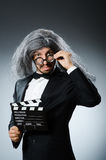 The funny man with movie clapboard Stock Photos