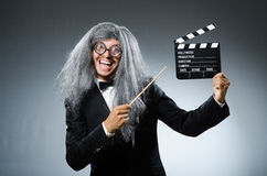 The funny man with movie clapboard Royalty Free Stock Photography