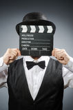 Funny man with movie clapper Royalty Free Stock Photography