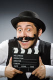 Funny man with movie clapper Stock Photography
