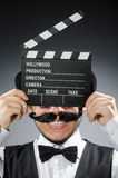 Funny man with movie Royalty Free Stock Photos
