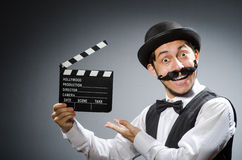 Funny man with movie clapper Royalty Free Stock Photos