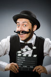 Funny man with movie Stock Photos