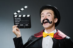 Funny man with movie Royalty Free Stock Photo