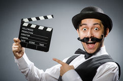 Funny man with movie. Clapper board Stock Photo