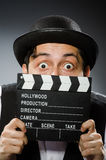 Funny man with movie Royalty Free Stock Images