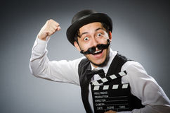 Funny man with movie Stock Image