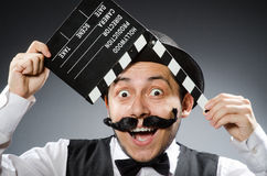 Funny man with movie Stock Photography