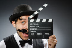 Funny man with movie Stock Images