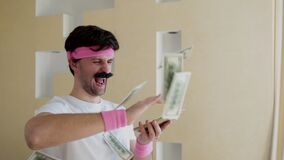Funny man with a mustache throws money
