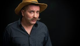 Funny man with mustache wearing shirt and hat Stock Photos