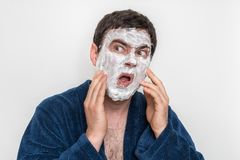 Funny man with natural white cream mask on his face royalty free stock photo
