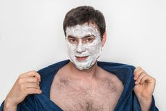 Funny man with natural white cream mask on his face stock photo