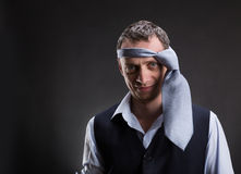 Funny man with necktie on his head Royalty Free Stock Photos