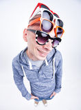 Funny man with pairs of sunglasses on his head - studio shot Royalty Free Stock Photo