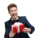 Funny man passes a present Royalty Free Stock Images