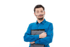 Funny man with pen between nose and lips Royalty Free Stock Image