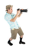 Funny man photographer making picture by camera. Royalty Free Stock Image