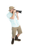 Funny man photographer making picture by camera. Stock Photography
