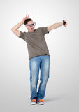 Funny man photographing himself on a smartphone Royalty Free Stock Images