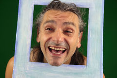 Funny man in a picture frame Royalty Free Stock Image